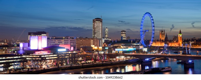 Panorama of the London night skyline with the South Bank and Waterloo Bridge with the Houses of Parliament