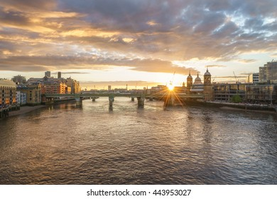 Panorama of London with Southwark bridge and St. Paul's cathedral at beautiful sunset