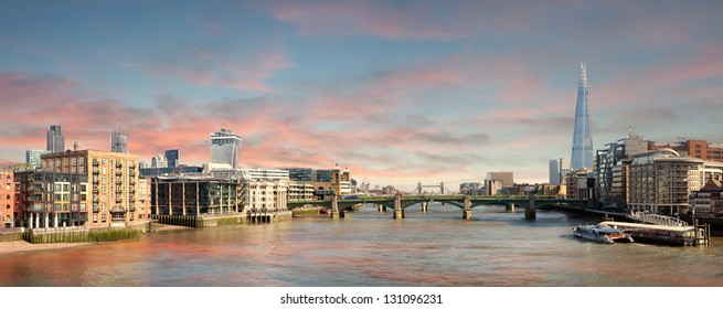 Panorama of London - view from Millenium Bridge towards Tower Bridge with the river Thames and skyscrapers in the City of London