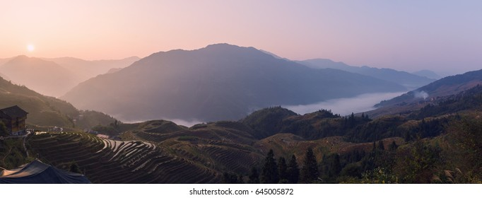 Panorama of the Longsheng Rice Terrace, also called the Longji Rice Terrace in China on sunrise.