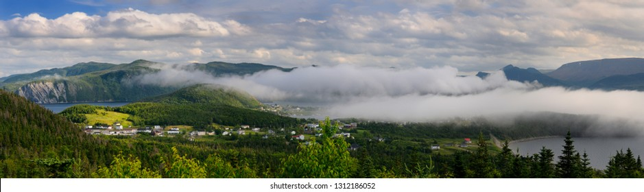 Panorama of low misty cloud a over Bonne Bay at Norris Point Newfoundland in the evening