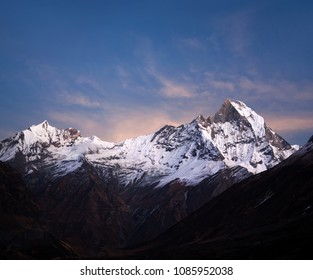Panorama of Machapuchare (Fishtail) mount at sunset, view from Annapurna base camp in the Nepal Himalayas. Machhapuchchare is a mountain in the Annapurna Himal of north Central Nepal.