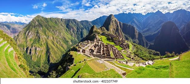 Panorama of the Machu Picchu or Machu Pikchu panoramic view in Peru. Machu Picchu is a Inca site located in the Cusco Region in Peru. Machu Picchu is one of the New Seven Wonders of the World.