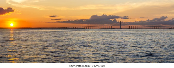 Panorama of the Manaus-Iranduba Bridge (called Ponte Rio Negro in Brazil) during the sunset. Bridge over the Rio Negro with 3595 meters of length that links the cities of Manaus and Iranduba.