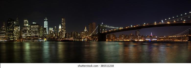 Panorama of Manhattan and Brooklyn Bridge / New York City