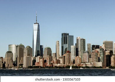 Panorama of Manhattan Downtown in dramatic colors with the One World Trade Center, New York, NY, United States of America. View from Ellis Island.