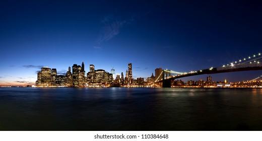 panorama of Manhattan Skyline at evening after sunset seen from Brooklyn Bridge Park, New York City, USA