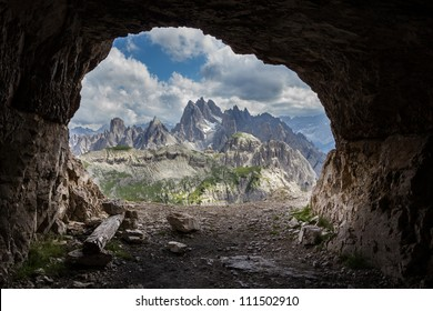 Panorama from man-made caves, Dolomites, Italy. In the peaks of Tre Cime di Lavaredo (Dolomites, Italy) there are a number of fortifications, man-made caves, and commemorative plaques (World War I).