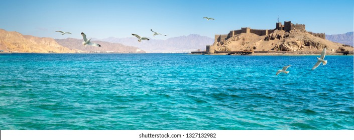 Panorama of medieval Castel of Saladin on the Pharaoh's Island in the Gulf of Aqaba. Old fortress of Sultan Salah El Din in Taba - ancient landmarks of an arabic culture on Sinai Peninsula, Egypt.