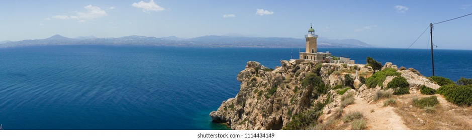 Panorama of Melagavi lighthouse with endless blue sea in the background in Loutraki, Peloponnese Greece