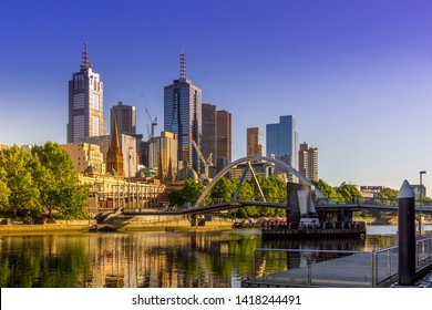 Panorama of Melbourne with Skyscrapers, Evan Walker Bridge and Yarra River against clear sky. High Resolution Photography.