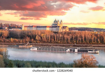 Panorama of Melk abbey with Danube river and autumn forest in Wachau, Austria