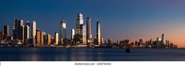 Panorama of Midtown Manhattan and Lower Manhattan at dusk. Blue hour photograph of the new New York skyline.