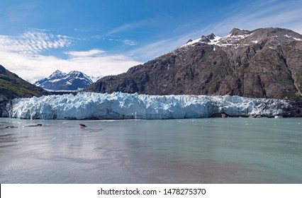 panorama of the mile-wide margerie glacier in alaska with mt fairweather in canada in the background on a rare clear day