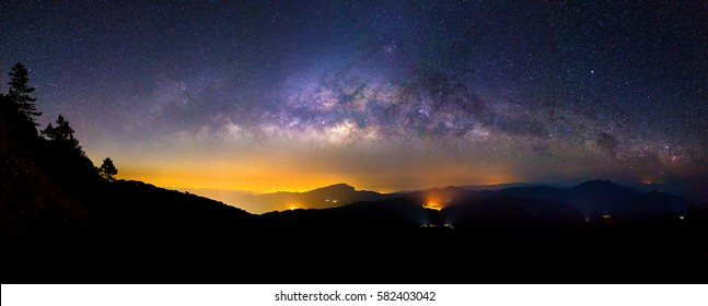 A Panorama of Milky Way in the darkest night with beautiful mountain shape. with grain effect.