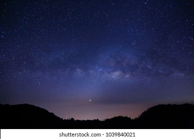 The Panorama Milky way galaxy with stars and space dust in the universe, Long exposure photograph, with grain.foreground summit tropical forest , thailand