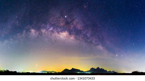 Panorama milky way at the lake with reflections in night time