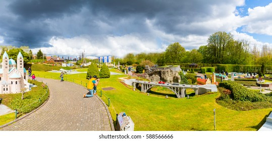 Panorama of the mini Europe city in Brussel, Belgium on the April 15, 2016. Miniature Sacre coeur or Monmart near to the Eiffel tower in the park. Amazing view of Europe.