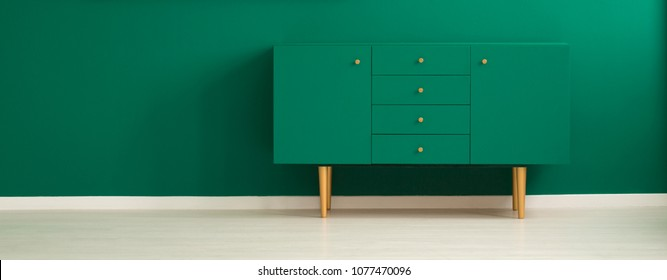 Panorama Of A Minimalist, Green Living Room Interior With A Modern, Teal  Sideboard With