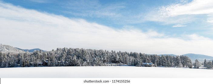 Panorama of Mirror Lake Winter Mountain Scene in Lake Placid New York