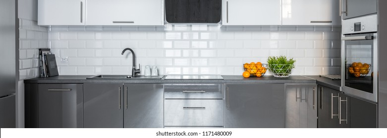 Panorama of modern kitchen with white metro tiles