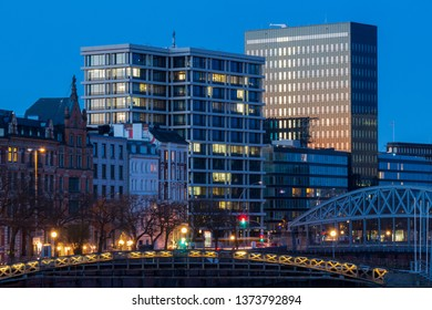 Panorama of modern Office Buildings in Hamburg reflecting sunset during blue hour
