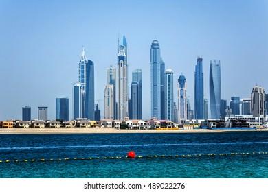 Panorama of modern skyscrapers in Dubai city from the Palm Jumeirah Island. Dubai, United Arab Emirates.