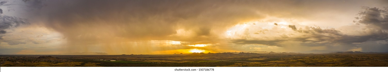 A panorama of a monsoon at sunset over the Sonoran desert of Arizona.