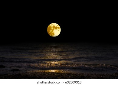 Panorama moon over the horizon on sea and moonlight. Landscape with the luna of night. Grand mystical fantastic view.