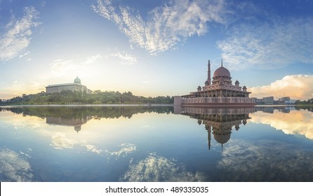 Panorama Morning reflections of Putra Mosque and Perdana Putra in Putrajaya, Malaysia.