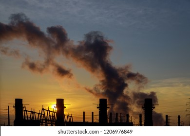 panorama at morning with steam from a power station coal power plant at sunrise