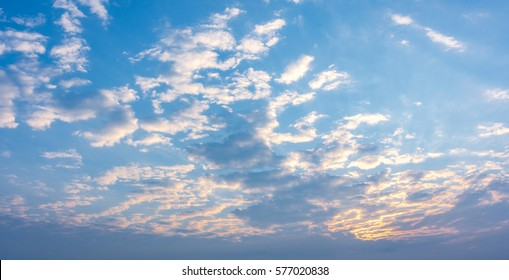 Panorama of Morning Sunrise with a perfect blue but cloudy sky.