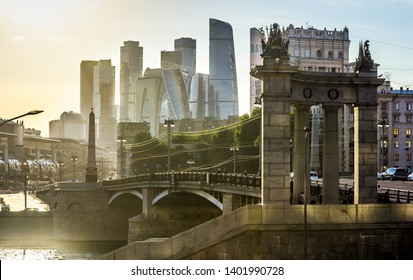 Panorama of Moscow with modern skyscrapers of Moscow-City, Russia. Sunny view of Borodinsky bridge over Moskva River in the Moscow center in summer. Beautiful cityscape of Moscow in sun light.