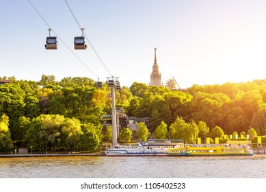 Panorama of Moscow in sun light, Russia. Scenic view of the cable car between Sparrow Hills and Luzhniki Stadium in summer Moscow. Cableway cabins hang over Moskva River at Moscow Luzhniki park.