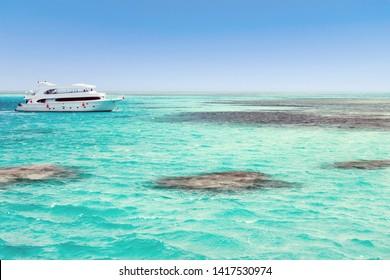 Panorama Motor Yacht seascape white sandy island Egypt Cruises Atoll. Landscape of the Red Sea.