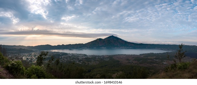Panorama of Mount Batur eastern ridge, and Batur crater lake in Bali, Indonesia