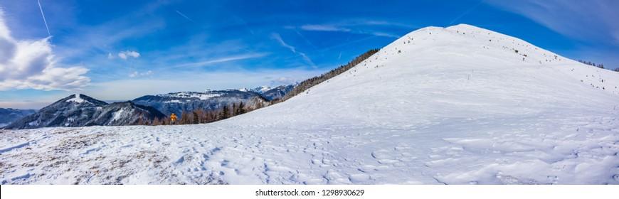 Panorama of the mount Lepenatka mountain summit and the Kamnik-Savinja Alps in the background, Slovenia
