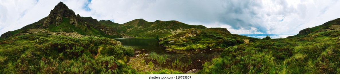 Panorama of a mountain lake in Ariege, Pyrenees, France