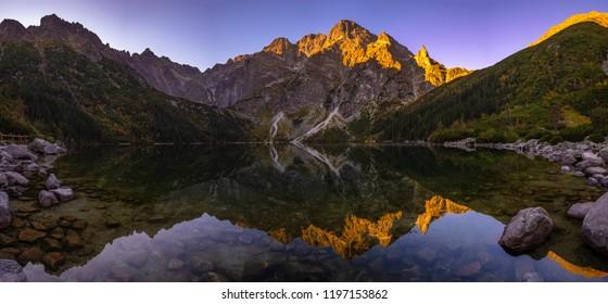 Panorama of a mountain lake during sunrise - Morskie Oko, Tatra Mountains, Poland