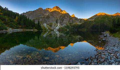 Panorama of a mountain lake during sunrise - Morskie Oko, Tatra Mountains, Poland