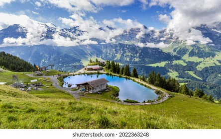 Panorama of the mountain lake Haerzlisee above the Engelberg in Titlis region, which offers diverse outdoor activities, such as hiking, climbing, skiing.
