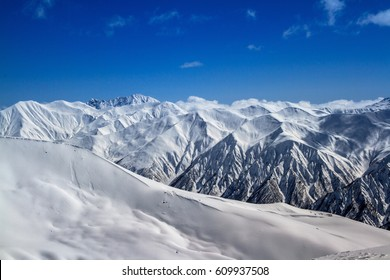Panorama of mountain peaks in the Caucasus, looks like the Alps.