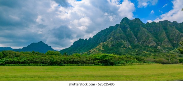 "Panorama of the mountain range by Kualoa Ranch in Oahu, Hawaii. Famous movies and TV shows like ""Lost"", ""50 First Kisses"" and ""Jurassic Park"" were filmed here"