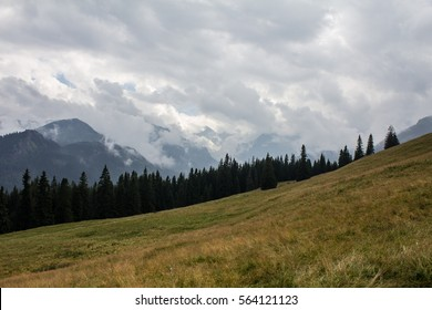 Panorama of the mountain range covered with clouds