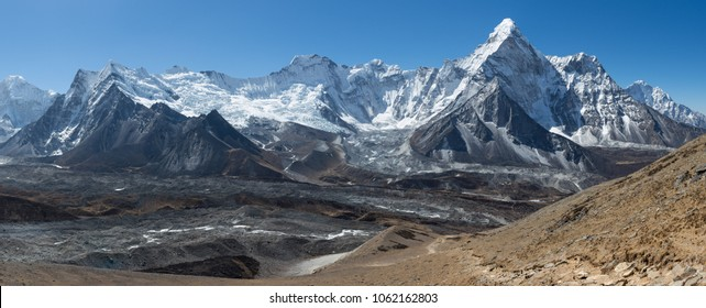 Panorama of a mountain range including one of the most beautiful mountains in the world 'Ama Dablam'  in the Himalayas, Nepal.