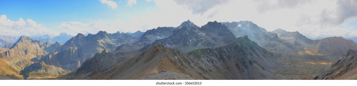 Panorama of Mountain Range Landscape with Blue And Grey Sky