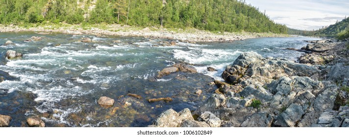 Panorama of a mountain river. A water summer landscape in the mountains of the Polar Urals.