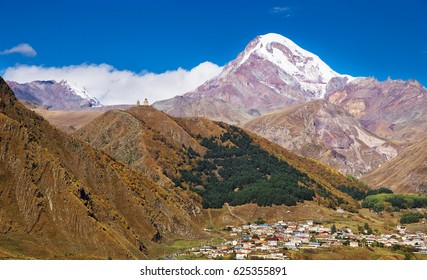 Panorama of the Kazbe? mountain and Stepancminda village, Georgia. It is also the second-highest volcanic summit in the Caucasus, after Mount Elbrus.