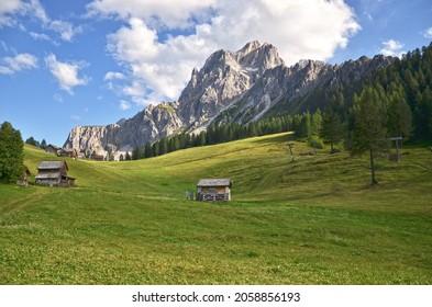 Panorama mountain view: Rugged rocks, green meadows  Sesto Croda Rossa, Dolomites, South Tyrol, Italy