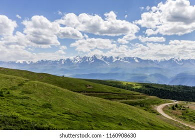panorama of mountains with a developing road